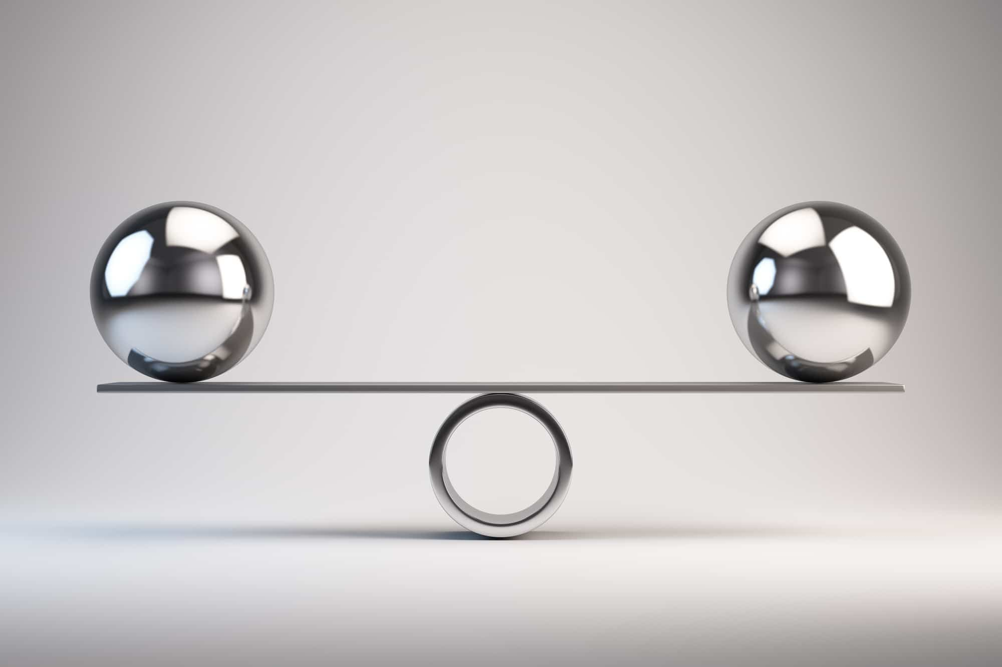 Photo of two metal spheres balancing on a sheet of metal